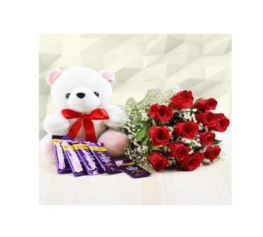 12 Red Roses Bouquet with 5 Dairy Milk and Teddy